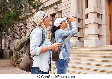 tourists photographing an historical building - two tourists...