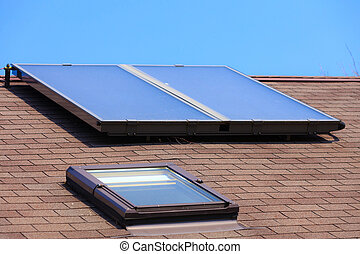 Renewable energy. Solar panel on roof. - Renewable...