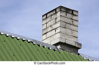 Brick chimney - Close up on the building roof and white...