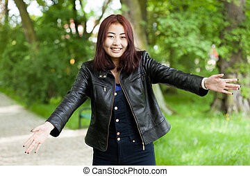 Happy girl with open arms - Potrait of happy asian girl with...