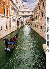 Trough the bridge - Gondolas passing over Bridge of Sighs -...