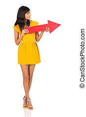 indian woman holding red arrow