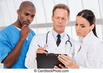 They need an expert advice Three confident doctors...