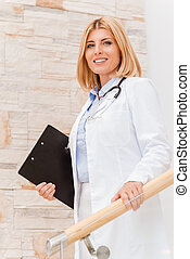 Confident and experienced female doctor Confident young...