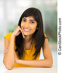 young indian woman relaxing at home