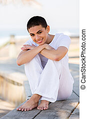 pretty young woman relaxing on beach