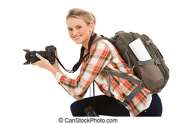 female photographer holding digital camera