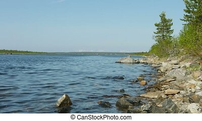 Northern landscape with Imandra lake with rocky shore. Russia