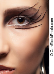 Close shot of an eye with gothic make up Professional...