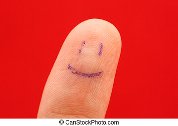 finger macro - A macro of a finger pad with a smiley painted...
