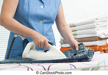 Woman ironing clothes - Close up of a woman ironing clothes...