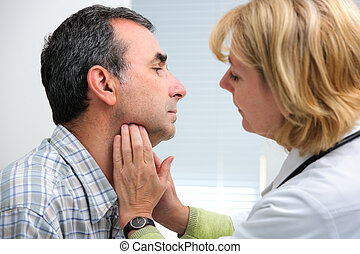thyroid function examination - female doctor touching the...