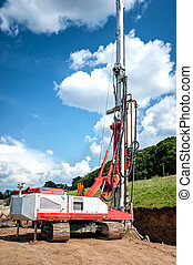 Industrial rig on construction site, drilling holes in the...