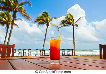 Drink on the beach - Cold Tequila Sunrise cocktail on the...