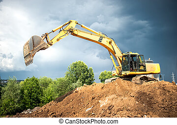 backhoe and industrial excavator working in construction...