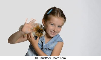 Little girl holding a guinea pig - Cute little girl holding...