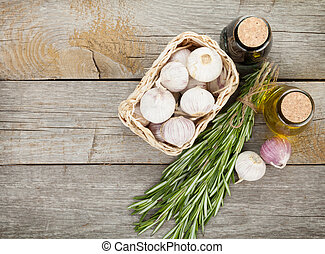 Herbs, spices and seasoning on wooden table background with...