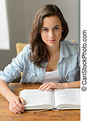 Student teenage girl reading book looking camera - Student...
