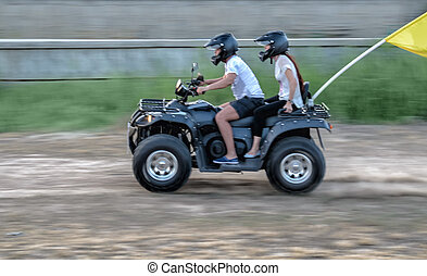 quad bike on a dirt road (all logos, inscriptions and...