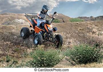 quad bike on a dirt road all logos, inscriptions and...