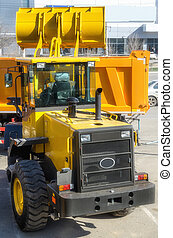 Construction Equipment - front loader loading the truck (all...