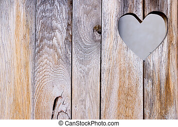 The wooden door with heart Background