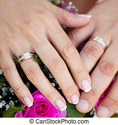 Hands and rings on wedding bouquet wedding theme background