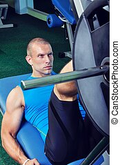 Muscular man exercising in a gym