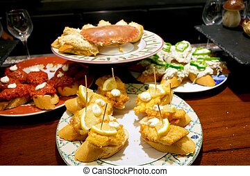 Basque pintxos - It is small snack typically eaten in bars,...