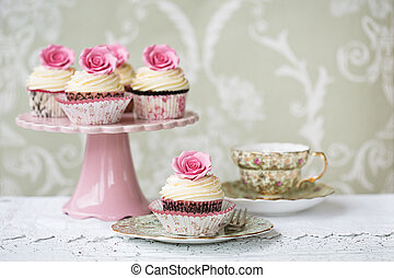 Afternoon tea with rose cupcakes served on vintage china