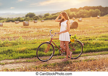 Beautiful woman with old bicycle - Beautiful woman old...