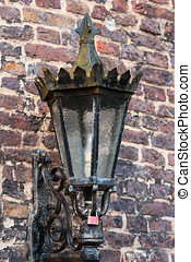 old lantern on a brick wall