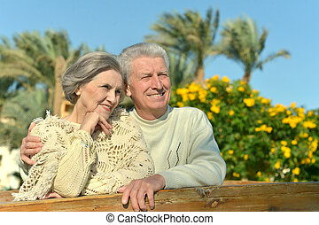 Couple in garden - Loving elder couple on a background of...
