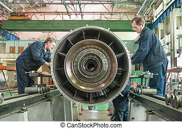 Workers assembly aviation engine - Tyumen, Russia - November...