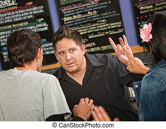 Cafe Owner with Rude Customer - Cafe owner talking with rude...