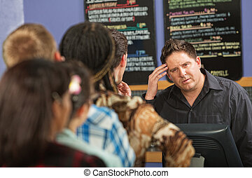 Long Line at Cafe - Confused barista at cash register in...