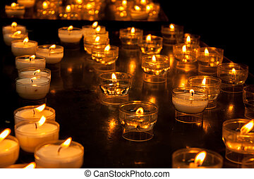 Romantic glowing long row of candlelight burning