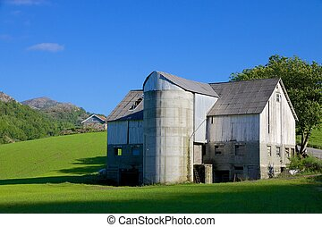Norwegian Grain Silo - Old, shabby Norwegian farm house and...