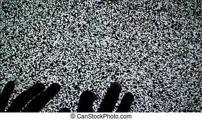 Hands crawling up the TV screen - Male hands crawling up the...