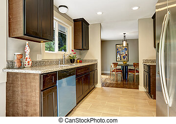 Modern kitchen inteior with dining area in new house -...