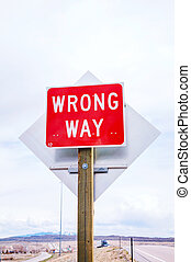 Wrong way sign at a highway in mountains