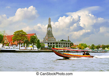 Long tail motor boat cruise in front of Wat Arun in...