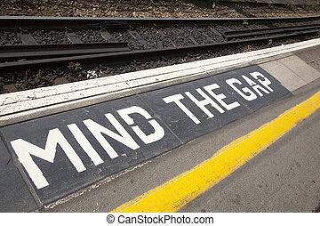Mind the Gap Platform Sign - Closeup of Mind the Gap...