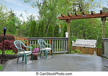 Wooden deck with garden swing - Cozy wooden deck with two...