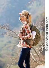 young female hiker on top of the mountain