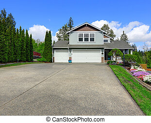 House exterior with curb appeal View of garage and driveway...