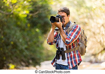 photographer taking photos in mountain - young photographer...