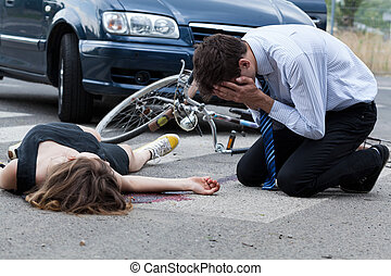Driver killed female biker - Horizontal view of driver who...