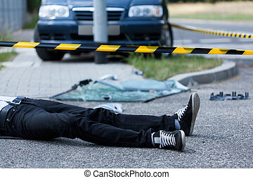 Man on the street after accident - Man lying on the street...