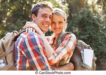 young couple hugging in the forest